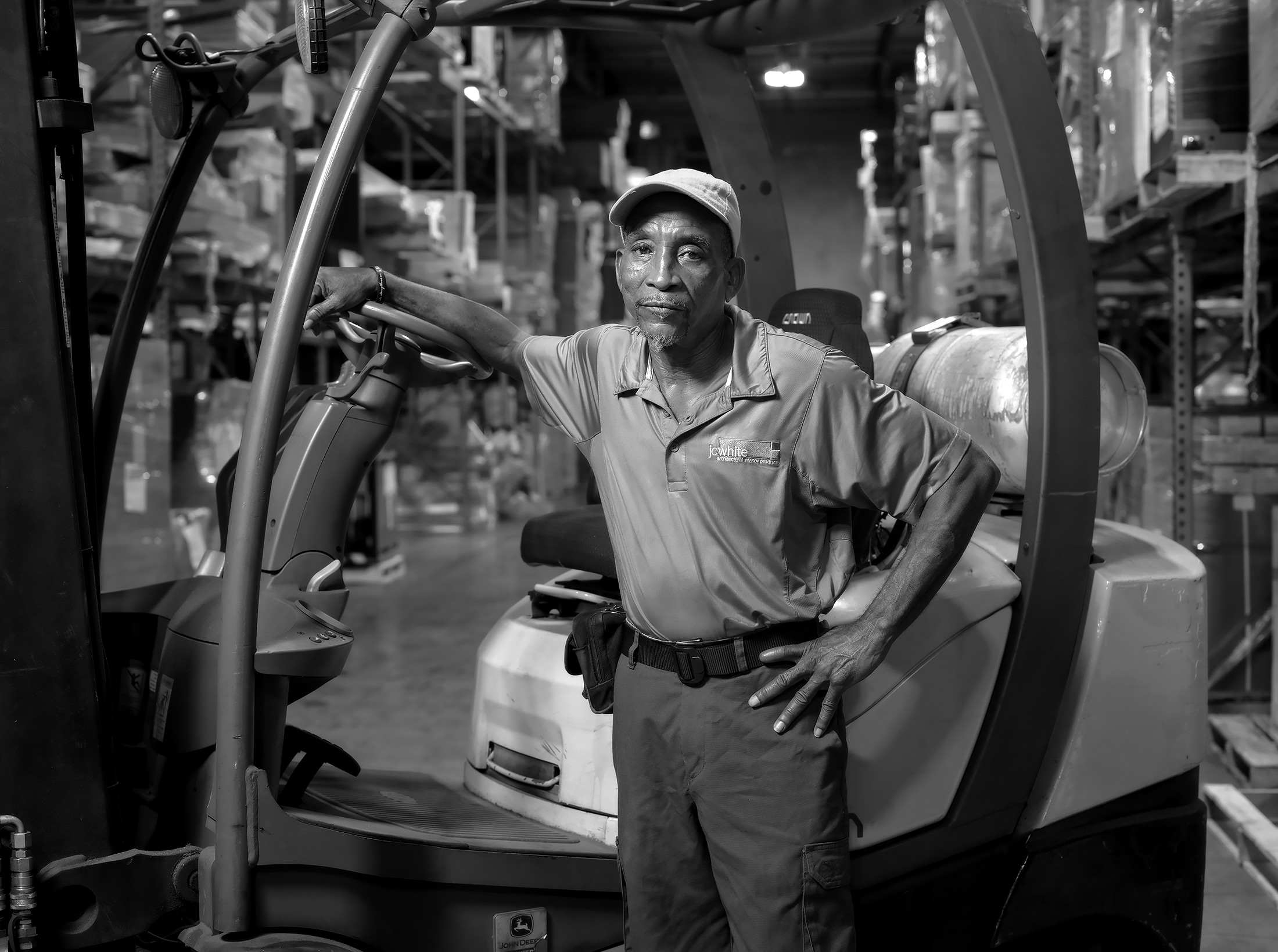 Portrait-of-Warehouse-Worker-with-Forklift